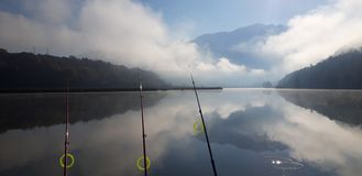 Fishing water and clouds royalty free stock photography