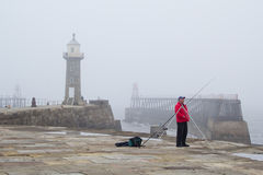 Fishing on Whitby pier Royalty Free Stock Images