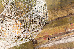 Fishing. White fishnet net on wooden background outdoor Royalty Free Stock Images