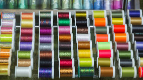 Fishing Wire for Hooks. Display with spools of thread for fishing line of different colors to make fish hooks in fishing with fly Stock Photography