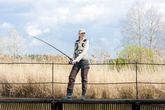 Fishing woman Stock Photos
