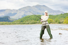 Fishing woman, Scotland Royalty Free Stock Photos