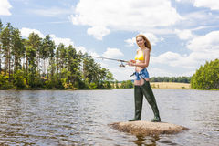 Fishing woman Stock Images