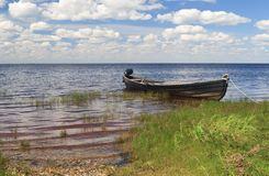 Fishing wooden boat in a lake, north Russia Stock Photos