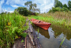 Fishing wooden boat at the lake Royalty Free Stock Images