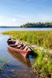 Fishing wooden boat at the lake Stock Images