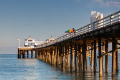 Fishing on a wooden pier in Malibu Stock Photos