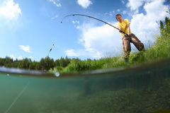 Fishing. Young man fishing on a green pond's coast with underwater view of weed on a bottom Stock Images
