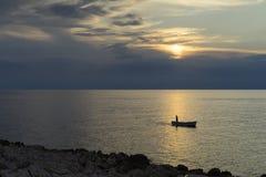 Fishingboat at Adriatic Sea in Razanj Croatia. Beautiful autumn evening at sunset. Nice peaceful outdoors image. Lovely landscape and nature picture. Joyful Royalty Free Stock Image