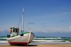 Fishingboat on the beach royalty free stock photo