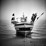 Fishingboat on the beach. Artistic look in black and white. Polish Baltic coast. Fishingboat after work on the beach in Sopot, Poland Stock Image