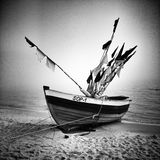 Fishingboat on the beach. Artistic look in black and white. Polish Baltic coast. Fishingboat after work on the beach in Sopot, Poland Stock Photos