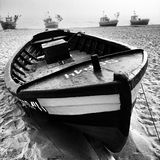Fishingboat on the beach. Artistic look in black and white. Stock Photos