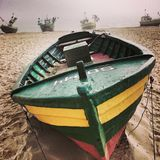 Fishingboat on the beach. Artistic look in vintage vivid colours. Polish Baltic coast. Fishingboat after work on the beach. Sopot, Poland Royalty Free Stock Images