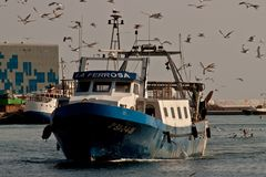 Fishingboat. Fishboat on a river in Barcelona Royalty Free Stock Image