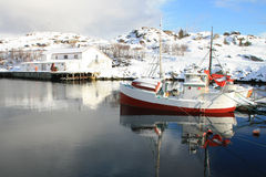 Fishingboat of Kraemmervika  in Lofoten. An old traditional boat in the innerst part  harbour of Kraemmervika in Lofoten islands Stock Photos