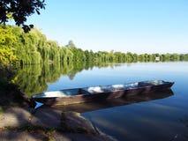 Fishingboat on the lake Stock Photography