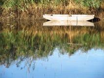 Fishingboat on the lake Stock Photo