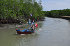 Fishingboat at the mangrove everglades in a small fishermans vil Stock Photo