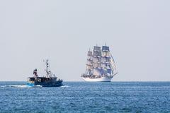 Fishingboat meets fullrigger Christian Radich. Swedish fishingboat meets Christian Radich, a Norwegian three-masted full-rigged ship at full sail in Souther Stock Photos