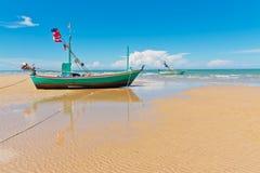 Fishingboat park at beauty beach Royalty Free Stock Photography