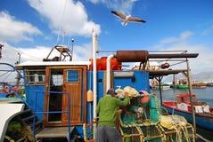 fishingboatflyover Arkivfoto