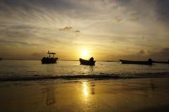 Fishingboats infront of sunset Royalty Free Stock Image