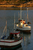 Fishingboats in the sunset. In northern Norway fishing is an important way of earning money Royalty Free Stock Image