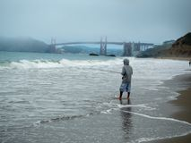 A Fishman in Baker beach San Francisco stock image