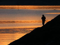 Fishman e tramonto 2 Fotografia Stock