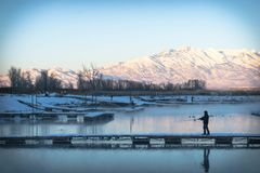 Fishing in the cold pond Royalty Free Stock Image
