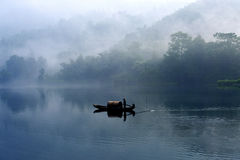 Fishman in the fog river Royalty Free Stock Photography