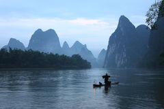 Fishman in Lijiang river dawn Royalty Free Stock Images