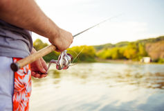 Fishman with rod at river Royalty Free Stock Image