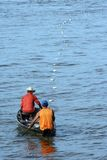 Fishmans in the canoe Stock Photo