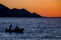 Fishmen на море Стоковое Фото