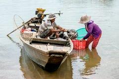 Fishmen pickup fish from boat Royalty Free Stock Photos