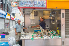 Fishmonger and customer Royalty Free Stock Photography