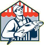 Fishmonger Holding Fish Retro Stock Photo