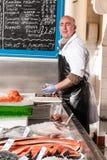 Fishmonger packaging smoked salmon, UK Royalty Free Stock Photo