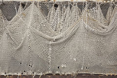 Fishnet. View of a white fishnet hung to dry Royalty Free Stock Photography
