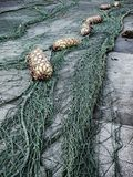 Fishnet and buoys. On the floor royalty free stock photography