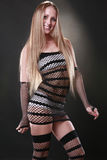 Fishnet diva. Cute blond in fishnet dress Royalty Free Stock Photography