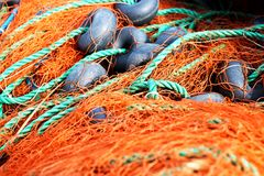 Fishing-net. Fishnet, a fabric with an open mesh resembling a fishing net royalty free stock image