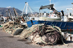 Fishnet and fishing boat Royalty Free Stock Images