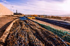 Fishnet. The fishing net dries in the sun at the port royalty free stock photos