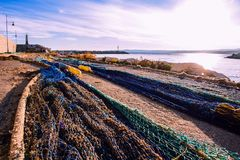 Fishnet. The fishing net dries in the sun at the port stock photo