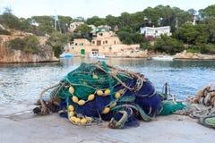 Fishnet in fishing village Cala Figuera and Mediterranean Sea, Majorca Stock Image