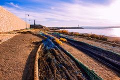 Fishnet. The fishing net dries in the sun at the port royalty free stock images