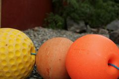 Fishnet Floats. Form a decoration in a garden in Honningsvag, Norway Stock Photo